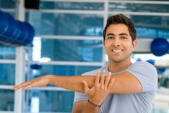Man stretching his arm Royalty Free Stock Images