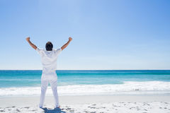 Man stretching his arms in front of the sea Stock Photos