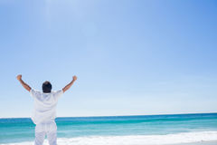 Man stretching his arms in front of the sea Royalty Free Stock Images