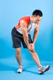 Man stretching his calf muscle Stock Images