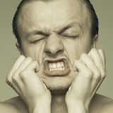 Man stretching his face Royalty Free Stock Photography