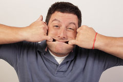 Man stretching his face. Image of a man stretching his face Stock Photos