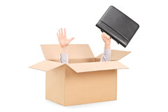 Man stretching his hands out of a box Royalty Free Stock Photography