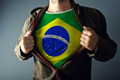 Man stretching jacket to reveal shirt with Brazil flag. Printed. Concept of patriotism and national team supporting royalty free stock photo