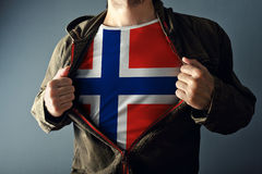 Man stretching jacket to reveal shirt with Norway flag. Printed. Concept of patriotism and national team supporting royalty free stock image