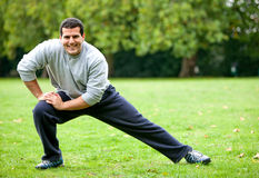 Man stretching outdoors Stock Images