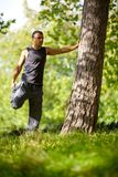 Man stretching outdoors Royalty Free Stock Photos