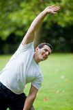Man stretching outdoors Stock Image