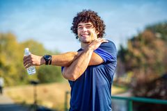 Man stretching outdoors - fitness, sport, training and lifestyle royalty free stock photo