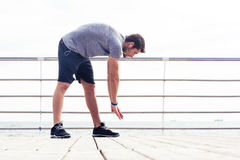 Man stretching outdoors Stock Photography
