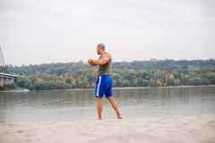 Man stretching outdoors Royalty Free Stock Image