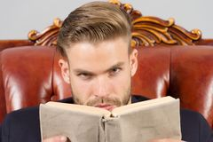 Man strict face reading book studying, self developing. Business education concept. Man with bristle as successful smart. Entrepreneur. Businessman formal suit Stock Images