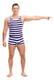 Man in a striped underwear pointing right Royalty Free Stock Image