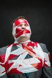 Man with stripped duct tape over body Stock Images