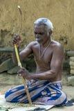 A man stripping a cinnamon in Sri Lanka. Stock Photos