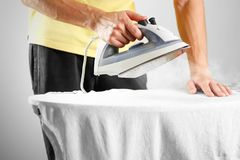 The man stroked the iron shirt. Close up. Isolated background royalty free stock photo