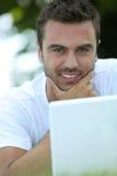 Man stroking his chin Stock Photo