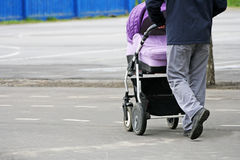 The man with the stroller. Stock Image