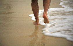 Man Strolling Through The Surf Stock Image
