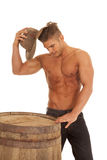 Man strong no shirt barrel look down hat Royalty Free Stock Photo