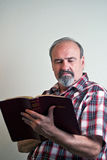 Man with strong religious beliefs. A man with strong convictions studies a bible Royalty Free Stock Photography