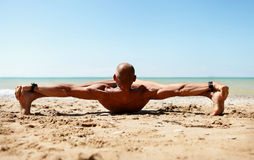 Man in strong stretching yoga pose Stock Image