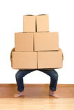 Man struggling with lots of cardboard boxes Stock Images