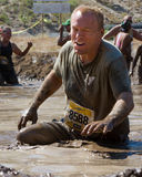 Man struggling through the mud Stock Photos