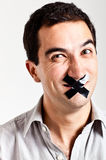 Man struggling to keep quiet Royalty Free Stock Images
