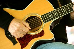 Man strumming guitar Royalty Free Stock Photos