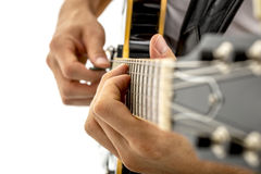 Man strumming a guitar Stock Images
