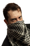 Man with Stubble on his face. Young man dressed in black t-shirt on the face of a Palestinian scarf. Stubble on his face. Isolated over white background Stock Photos