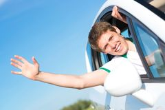 Man stuck his hand out of the window stock photo