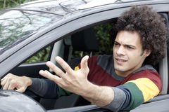 Man stuck in traffic angry driving car Royalty Free Stock Image