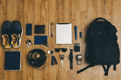 Man Student Outfit. Man student hipster outfit from bag on wooden background Royalty Free Stock Images