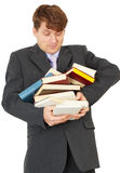 Man - student hold heap of books and textbooks Stock Photo