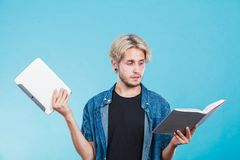 Man student holding tablet and book. stock photography