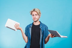 Man student holding tablet and book. Royalty Free Stock Images