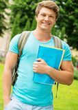 Man student in a park Royalty Free Stock Image