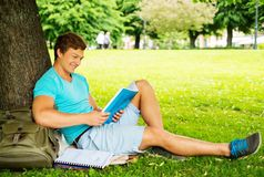 Man student in a park Stock Photo