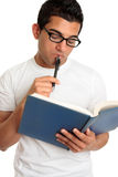 Man or student pondering or thinking intently Stock Photography