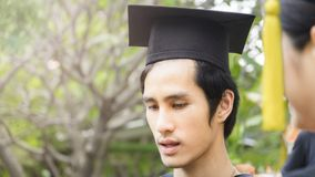 Man student smiles and feel happy in  graduation gowns and cap. The man student smiles and feel happy in  graduation gowns and cap Royalty Free Stock Images