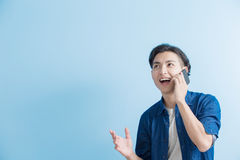 Man student talk on phone. Isolated on blue background,asian Stock Photography