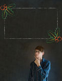 Man, student or teacher hand on chin with Christmas holly menu to do checklist Stock Photography