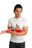 Man or student writing in a notebook Royalty Free Stock Photography
