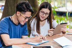 Man students and girlfriend are during reading information from stock photography