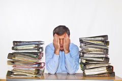 Man studies folder with files at his desk. In the office Stock Photos