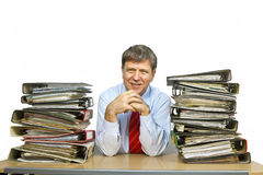 Man studies folder with files at Royalty Free Stock Photography