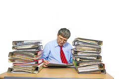 Man studies folder with files at Stock Images