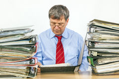 Man studies folder with files at Royalty Free Stock Photo